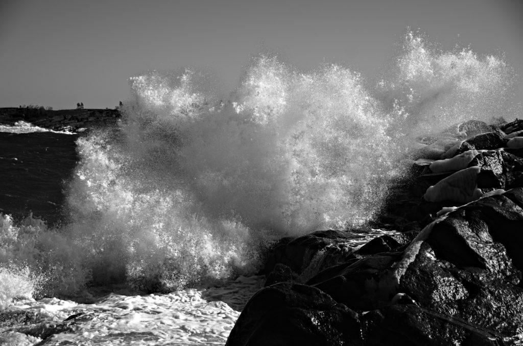 Wave throws itself against the rocks at Havsvidden Resort, Geta, The Åland Islands.